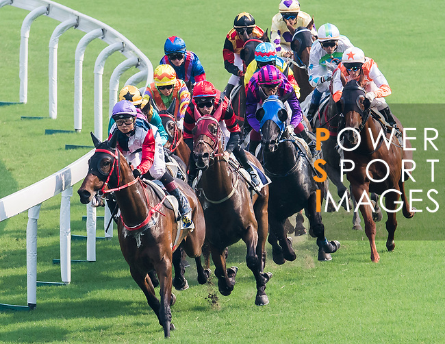 Horse Autopay #11 (left) ridden by Dylan Mo Hin-tung competes during the race 6 of HKJC Horse Racing 2017-18 at the Sha Tin Racecourse on 16 September 2017 in Hong Kong, China. Photo by Victor Fraile / Power Sport Images
