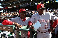SAN FRANCISCO - JUNE 12:  Manager Dusty Baker and coach Billy Hatcher of the Cincinnati Reds talk in the dugout before the game against the San Francisco Giants at AT&T Park on June 12, 2011 in San Francisco, California. Photo by Brad Mangin
