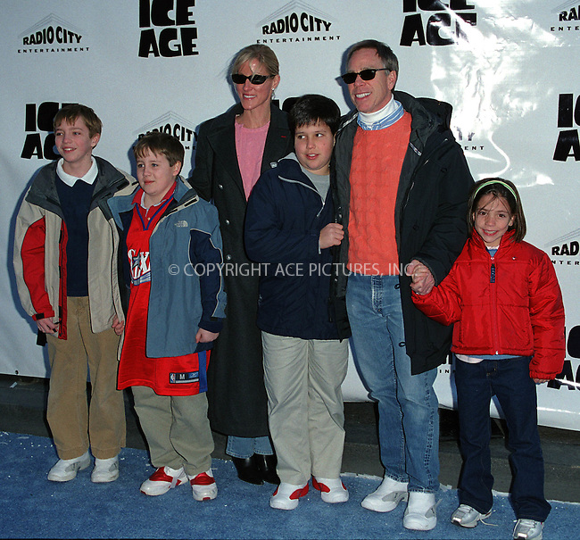 """Designer TOMMY HILFIGER with his girlfriend Lizzie Somerby and kids attend the world premiere of """"Ice Age"""" at the Radio City Music Hall in New York. March 10, 2002. © 2002 by Alecsey Boldeskul/NY Photo Press.   ..*PAY-PER-USE*      ....NY Photo Press:  ..phone (646) 267-6913;   ..e-mail: info@nyphotopress.com"""
