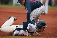 17 October 2010: Chris Goniot of Savigny slides safely into third base as Boris Marche fails to tag him out during Rouen 10-5 win over Savigny, during game 2 of the French championship finals, in Savigny sur Orge, France.