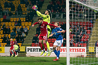 24th November 2019; McDairmid Park, Perth, Perth and Kinross, Scotland; Scottish Premiership Football, St Johnstone versus Aberdeen; Zander Clark of St Johnstone holds a cross under pressure from Bruce Anderson of Aberdeen  - Editorial Use