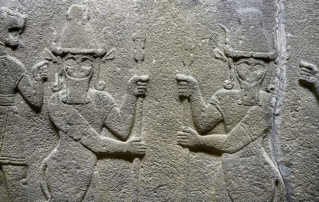Hittite relief sculpted orthostat stone panel of Herald's Wall. Basalt, Karkamıs, (Kargamıs), Carchemish (Karkemish), 900-700 B.C. Anatolian Civilisations Museum, Ankara, Turkey.<br /> <br /> Protective mixed creatures. One each hand of the lion-headed men is in the form of a fist. The mace on the left is over the head of the weapon on the right. The two bull-men in the middle carry one spear each in their hands. Bull-man is known as Kusarikku, and the lion-man is known as Ugallu.