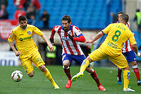Atletico Madrid´s Spanish midfielder Cani and Getafe´s Lacen and Baba