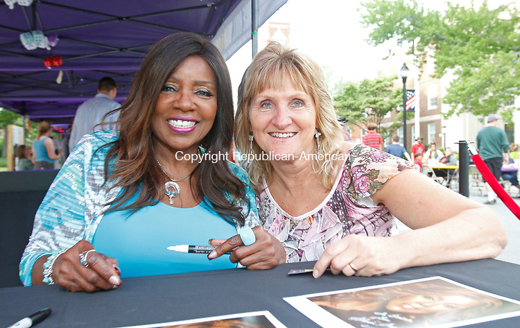 Torrington, CT- July 072717MK06 Gloria Gaynor and Donna Ellis pose for a photo opprotunity at the Main Street Marketplace in Torrington Thursday evening.  Gaynor greeted dozens of fans and took photos with them along with signing autographs at the event.  Michael Kabelka / Republican-American