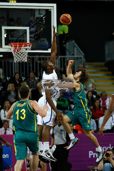 Matthew Dellavedova (Australia) and Kevin Seraphin (France) compete for the ball. France v Australia. The London International Basketball Invitational. London Prepares for Olympics 2012. Basketball Arena, Olympic Park. London. 17/08/2011. MANDATORY Credit Sportinpictures/Paul Chesterton - NO UNAUTHORISED USE - 07837 394578.
