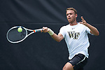 Bar Botzer of the Wake Forest Demon Deacons returns the ball against the Texas A&M Aggies during his match at #4 singles in the semifinals of the 2018 NCAA Men's Tennis Championship at the Wake Forest Tennis Center on May 21, 2018 in Winston-Salem, North Carolina. The Demon Deacons defeated the Aggies 4-3. (Brian Westerholt/Sports On Film)