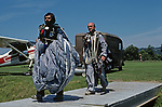 Two instructors carrying gear back to training center after making a successful jump