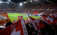 Fussball International  WM Qualifikation 2014   in Bern Schweiz - Slowenien         15.10.2013 Stadionuebersicht mit Schweizer Fahnen beim Einlauf der Mannschaften ins Stade de Suisse