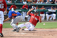 Boston Red Sox shortstop Garin Cecchini (70) scores the game winning run as the ball gets away from pitcher Cory Mazzoni (47) during a Spring Training game against the New York Mets on March 16, 2015 at JetBlue Park at Fenway South in Fort Myers, Florida.  Boston defeated New York 4-3.  (Mike Janes/Four Seam Images)