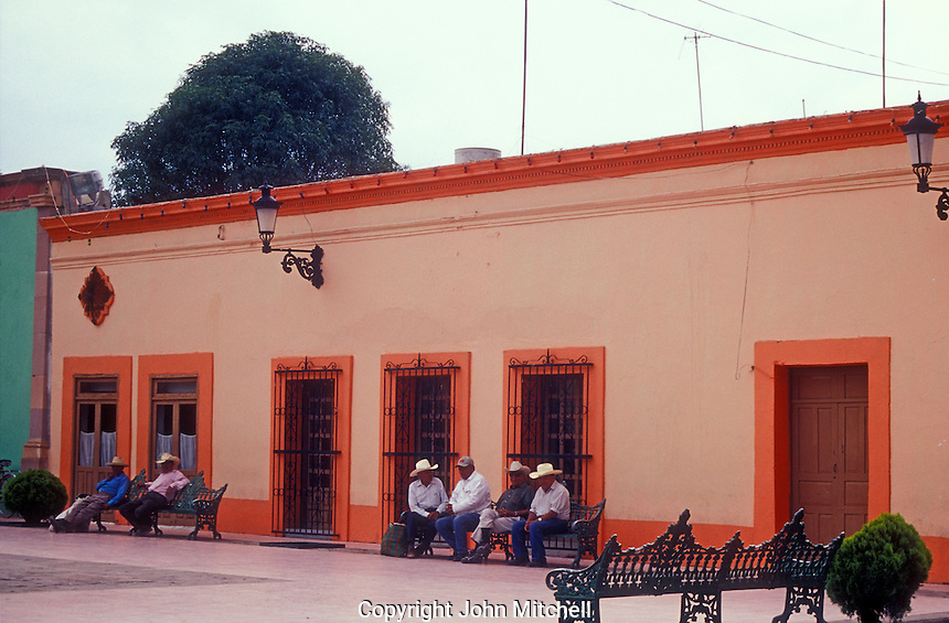 Mexican men relaxing in the town of Dolores Hidalgo, Mexico