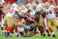 Sept. 13, 2009; Glendale, AZ, USA; Arizona Cardinals running back (26) Beanie Wells is tackled by San Francisco 49ers defenders at University of Phoenix Stadium. San Francisco defeated Arizona 20-16. Mandatory Credit: Mark J. Rebilas-
