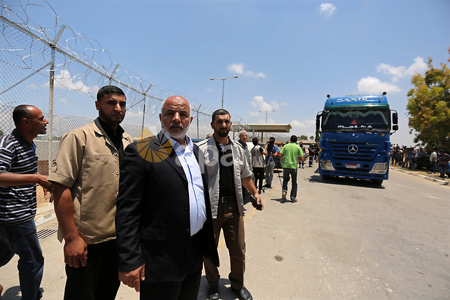 Tawfiq Abu Naim Undersecretary of the Ministry of Interior inspects arrival of Egyptian trucks carrying fuel Gaza's power plant in Nusseirat, in the central Gaza Strip after entering the southern Gaza Strip from Egypt through the Rafah border crossing on June 21, 2017. Egypt began to deliver a million litres of fuel to Gaza, a Palestinian official said, in an attempt to ease the Palestinian enclave's desperate electricity crisis. The fuel, trucked in through the Rafah border between Egypt and Gaza, will be routed to the territory's only power station -- closed since April due to fuel shortages. Photo by Ashraf Amra