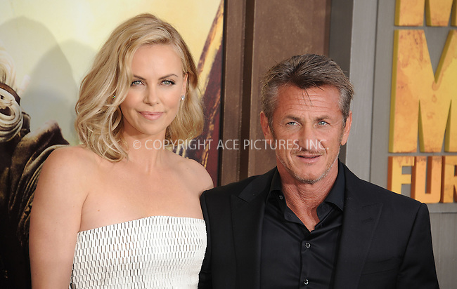 WWW.ACEPIXS.COM<br /> <br /> May 7 2015, LA<br /> <br /> Actress Charlize Theron and Sean Penn arriving at the premiere  'Mad Max: Fury Road' at the TCL Chinese Theatre on May 7, 2015 in Hollywood, California. <br /> <br /> By Line: Peter West/ACE Pictures<br /> <br /> <br /> ACE Pictures, Inc.<br /> tel: 646 769 0430<br /> Email: info@acepixs.com<br /> www.acepixs.com