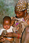 San Bushmen mother and child, Kalahari Desert, Botswana