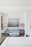 The master bedroom, with adjoining sitting room, is of a classic contemporary design scheme, which emphasizes pale muted colours and simple architectural forms.