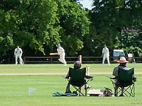 Playing cricket, Bloxham, Oxfordshire.