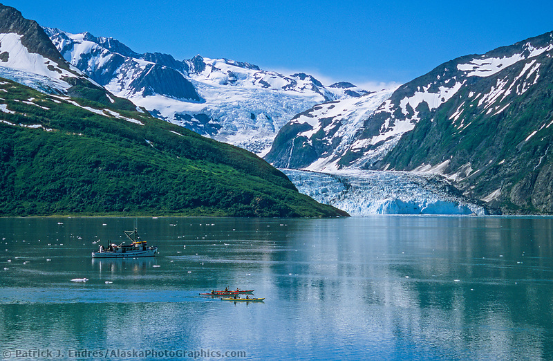 Kayakers and tour boat in Harriman fjord, surprise glacier, Chugach mountains, Prince William Sound, Alaska