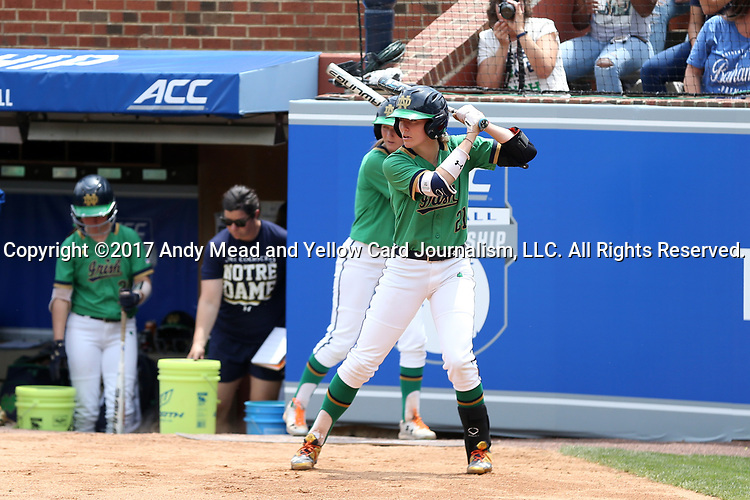 CHAPEL HILL, NC - MAY 11: Notre Dame's Karley Wester (21) and her younger sister Ali Wester (behind) both time their swings as Boston College's pitcher throws warmup pitches. The #4 Boston College Eagles played the #5 University of Notre Dame Fighting Irish on May 11, 2017, at Anderson Softball Stadium in Chapel Hill, NC in a 2017 Atlantic Coast Conference Tournament Quarterfinal Softball game. Notre Dame won the game 9-5 in eight innings.