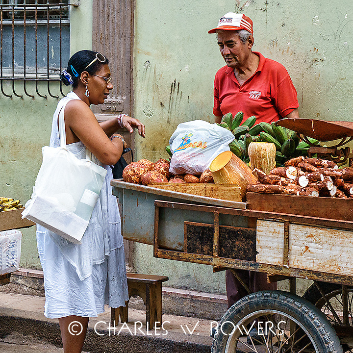 Faces Of Cuba - Shopping for veggies at the street vendor.<br />