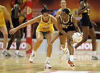 09.07.2011 Australia's Mo'onia Gerrard and Jamaica's Nadine Bryan in action during the netball match between Jamaica and Australia at the Mission Foods World Netball Championship 2011 held at the Singapore Indoor Stadium in Singapore . Mandatory Photo Credit ©Michael Bradley.