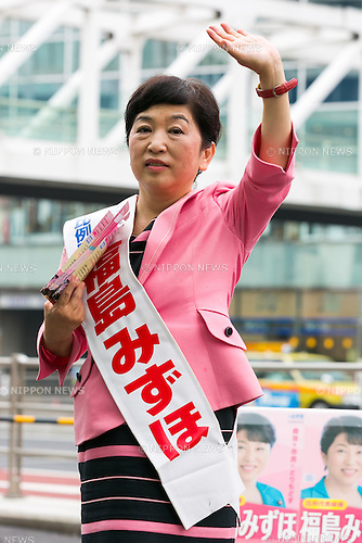 Mizuho Fukushima, Member of the House of Councillors and Social Democratic Party candidate for next House of Councillors elections, campaigns outside Shinjuku Station on July 1, 2016, Tokyo, Japan. Fukushima and the Social Democratic Party, along with the with the Democratic Party and the Japanese Communist Party, are calling on the public to participate in the next House of Councillors elections to try to stop the Liberal Democratic Party of Prime Minister Shinzo Abe from returning a majority. This is the first time that young voters (18 and 19 year-olds) will be allowed to take part in the elections. (Photo by Rodrigo Reyes Marin/AFLO)
