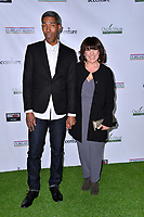 SANTA MONICA, CA. February 21, 2019: Tara Flynn &amp; Carl Austin at the 14th Annual Oscar Wilde Awards.<br /> Picture: Paul Smith/Featureflash