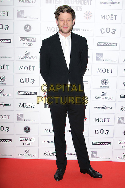 James Norton.14th Moet British Independent Film Awards 2011, Old Billingsgate, Lower Thames Street, London, England, 4th December 2011.full length black suit white shirt beard facial hair hands in pockets .CAP/CJ.©Chris Joseph/Capital Pictures.