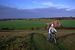 ARM491 Child on country bike ride Burrow Hill Butley Suffolk England