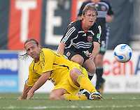U.S. Open Cup Round of 16: Columbus Crew's forward Sebastian Rozental (22) fights for the ball with DC United's Brian Carroll (16). DC United defeated the Columbus Crew in overtime 2-1, Tuesday, August 1, 2006, at Maryland Soccerplex.