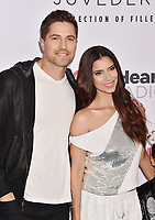 CARSON, CA - JUNE 01: Eric Winter (L) and Roselyn Sanchez attend 2019 iHeartRadio Wango Tango at The Dignity Health Sports Park on June 01, 2019 in Carson, California.<br /> CAP/ROT/TM<br /> ©TM/ROT/Capital Pictures
