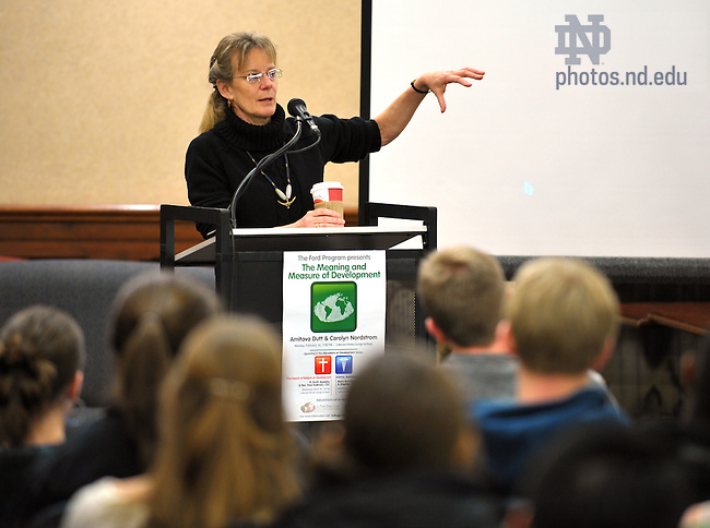 """Professor Carolyn Nordstrom delivers a lecture in the Coleman-Morse Lounge on """"The Meaning and Measure of Development""""..Photo by Matt Cashore/University of Notre Dame"""