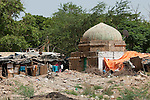 A slum that surrounds a  Lodhi Period tomb complex at Nizamuddin in Delhi, India. The Archaeological Survey of India has been on a campaign to evict people who have illegally made the tombs their homes throughout the city in recent times but is facing stiff opposition from the residents. The area is littered with tombs that need excavation.