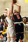 WATERBURY CT. 16 February 2018-021619SV21-#5 Jordyn Forte of Watertown High puts up a shot over #5 Paige Carroll of Sacred Heart High during the NVL girl&rsquo;s basketball tournament in Waterbury Saturday.<br /> Steven Valenti Republican-American