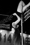 Bao-Jhong Yi-min Temple, Kaohsiung -- Pole dancer hanging upside down from a pole at the annual 'Divine Pig' (Shen Zhu) festival during Ghost Month.