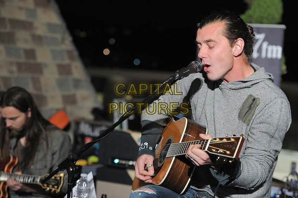 Gavin Rossdale.98.7FM Presents Bush  in an exclusive live performance at the 98.7FM Penthouse inside the Historic Hollywood Tower in Hollywood, California, USA..January 31st, 2012     .on stage in concert live gig performance performing music half length grey gray hooded top singing profile                                                            .CAP/RKE/DVS.©DVS/RockinExposures/Capital Pictures.
