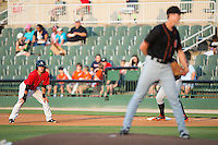 Eddy Alvarez (1) of the Kannapolis Intimidators keeps his eye on Delmarva Shorebirds starting pitcher Matthew Grimes (29) as he takes his lead off of first base at CMC-Northeast Stadium on June 6, 2015 in Kannapolis, North Carolina.  The Shorebirds defeated the Intimidators 7-2.  (Brian Westerholt/Four Seam Images)