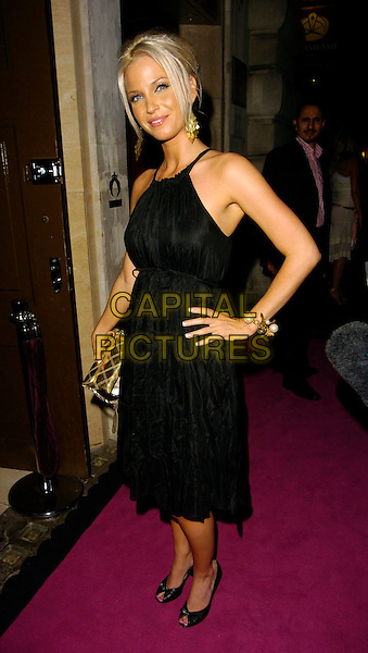 SARAH HARDING.The Pout Cosmetic Range 5th Birthday Party, Cuckoo Club, London, UK..July 18th, 2006.Ref: CAN.full length black dress halterneck gold purse hand on hip.www.capitalpictures.com.sales@capitalpictures.com.©Can Nguyen/Capital Pictures