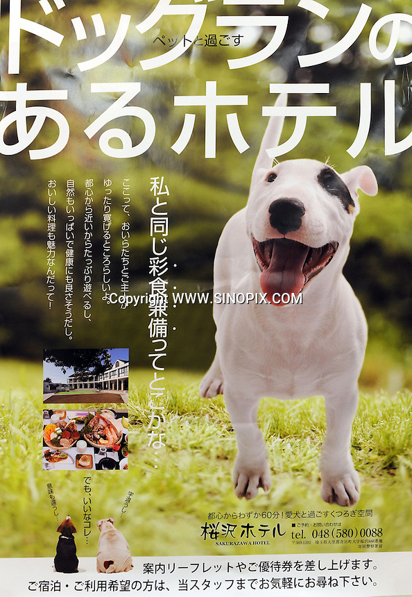 An advert for a dog hotel advertised in Tokyo. <br /> 20-Jan-2011