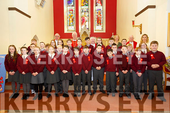 Ms Kathleen Phelan's 5th class pupils from Duagh NS who were Confirmed in St Brigid's Church, Duagh by the Bishop of Kerry Ray Browne on Tuesday, pictured with Ms Phelan, Principal Ciara O'Connor, Canon Declan O'Connor, Bishop Browne, Fr Tom McMahon and Fr Jack O'Donnell.