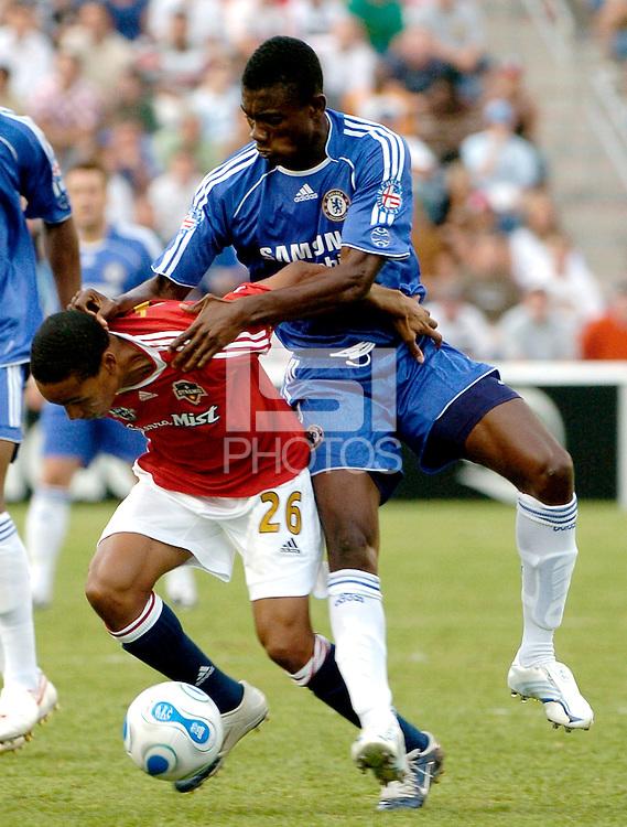 Chelsea FC forward Salomon Kalou (21) jumps on the back of MLS All-Star midfielder Ricardo Clark (26).  The MLS All-Stars defeated Chelsea FC 1-0 at Toyota Park in Bridgeview, IL on August 5, 2006.