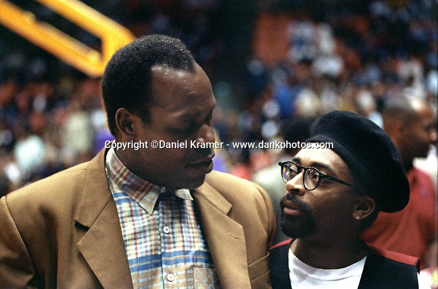 Danny Glover and Spike Lee chat courtside during a Los Angeles Lakers game at the Forum in 1992.