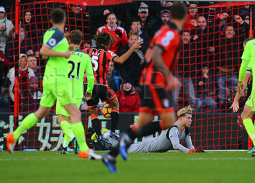 04.12.2016. Vitality Stadium, Bournemouth, England. Premier League Football. AFC Bournemouth versus Liverpool. Liverpool Goalkeeper Loris Karius fumbles the ball and Bournemouth Defender Nathan Ake pounces to give Bournemouth a 4-3 lead and winning goal