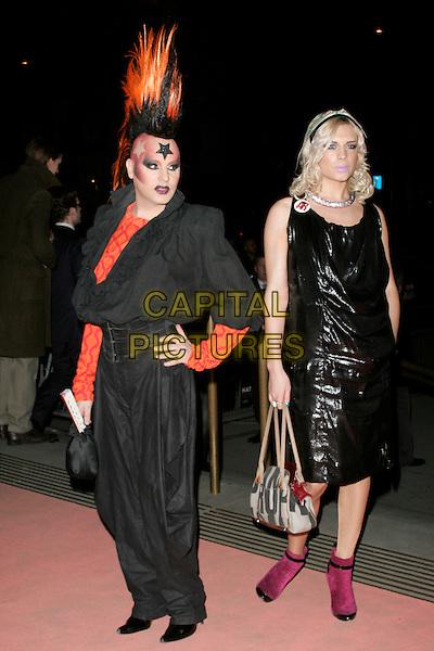 GUESTS.Hats: An Anthology By Stephen Jones - Private View at the Victoria & Albert Museum, London, England..February 23rd, 2009 .V&A V & A full length black dress shiny hair mohawk orange make-up makeup make up star pink ankle boots .CAP/AH.©Adam Houghton/Capital Pictures.
