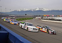 Feb 21, 2009; Fontana, CA, USA; NASCAR Camping World Truck Series drivers Kyle Busch (51) and Johnny Benson (1) lead the field to the green flag of the San Bernardino County 200 at Auto Club Speedway. Mandatory Credit: Mark J. Rebilas-