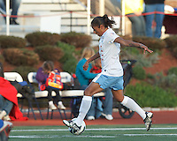 Chicago Red Stars forward Maribel Dominguez (9) brings the ball forward.  In a National Women's Soccer League Elite (NWSL) match, the Boston Breakers (blue) defeated Chicago Red Stars (white), 4-1, at Dilboy Stadium on May 4, 2013.