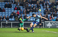 Goalkeeper Reice Charles-Cook of Coventry City saves from Luke O'Nien of Wycombe Wanderers during the The Checkatrade Trophy - EFL Trophy Semi Final match between Coventry City and Wycombe Wanderers at the Ricoh Arena, Coventry, England on 7 February 2017. Photo by Andy Rowland.
