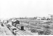 D&amp;RG Chama yards with lots of freight cars on hand.  Photo taken from coaling trestle looking south.  Catch the pile of wagons and parts at the right-hand edge.<br /> D&amp;RG  Chama, NM  Taken by Werner, Charles A. - ca. 1910