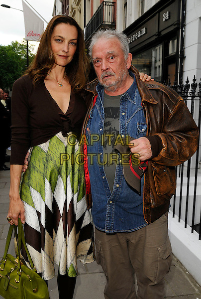 CATHERINE & DAVID BAILEY  .The Scream in High Definition private view, Scream Gallery, London, England..July 10th, 2008.half 3/4 length brown leather jacket brown beige trousers blue denim shirt green white pattern dress cardigan bag purse married husband wife stubble facial hair .CAP/CAN.©Can Nguyen/Capital Pictures.