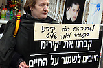 A berieved parent is seen holding a sign calling for the release by Israel, of terrorists in exchange for Gilad Shalit, outside the protest tent the Shalit family set up next to the Prime Minister's residence, March 15th, 2009. Negotiations with Hamas have reached a dead end, and a final decision is said to be made on Monday, just days before the end of the Olmert administration. Photo By : Emil Salman / JINI