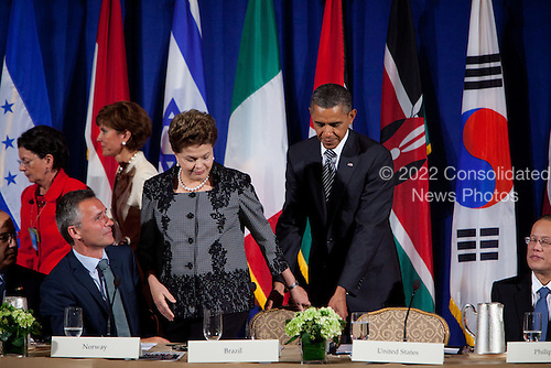 United States President Barack Obama, right, holds a chair for President Dilma Rousseff of Brazil, center, as they arrive for a meeting of the Open Government Partnership, a global effort to make governments better at the Waldorf-Astoria in New York, New York on Tuesday, September 20, 2011.  From left to right: Jens Stoltenberg, Prime Minister of Norway; President Dilma Rousseff of Brazil; President Barack Obama; and President Benigno S. Aquino III of Philippines..Credit: Allan Tannenbaum / Pool via CNP